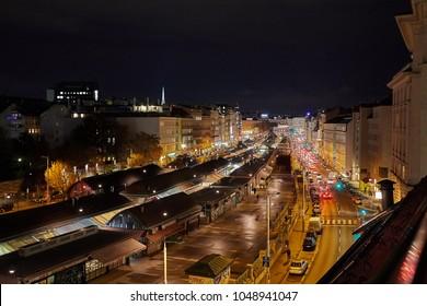 Urban street at night with traffic. Vienna Naschmarkt