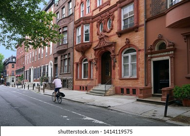 urban street with old brownstone style townhouses or apartment buildings