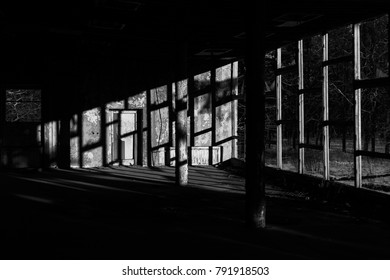 Urban sunset. Sunset in abandoned house. Afternoon sunrays. Shadows on the wall. Stalker theme.