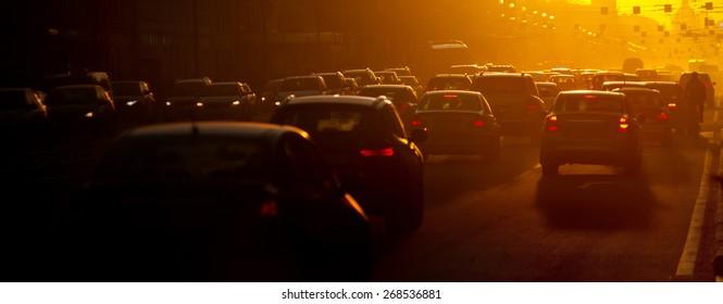 Urban traffic jam at the evening, sunlight