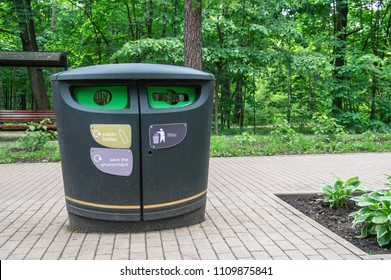 Urban waste separate collection system. Dumpster contemporary design. Modern smart collection waste. Separate collection of garbage and biodegradable waste. Junk, recovery. Outdoor Trash Cans in park.