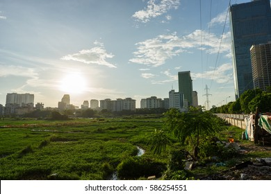 Urban wasteland with meadow in Hanoi capital city, Vietnam