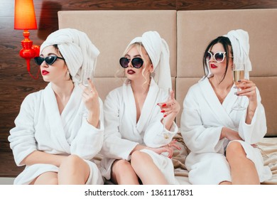 Urban women luxury. Arrogance and skepticism. Champagne relaxation leisure. Sunglasses, bathrobes and turbans on.