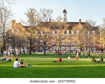 URBANA, ILLINOIS - APRIL 17, 2016:  Students mingle on Quad lawn of  University of Illinois college campus in Urbana Champaign