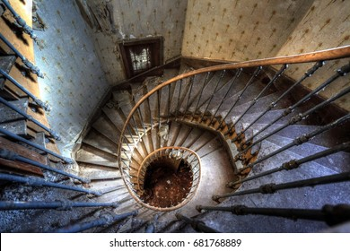 Urbex (Urban Exploration): spiral staircase in an abandoned villa