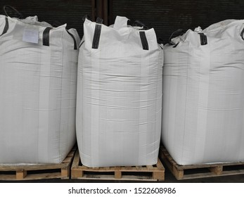 Urea Stock pile jumbo-bag in warehouse waiting for shipment.Put on wooden pallets