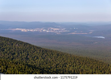 Urenga mountain range near Zyuratkul national Park. Naked mountain (the second hill), an altitude of 1198 meters. In the distance is seen the Zlatoust sity. Chelyabinsk region, South Ural, Russia