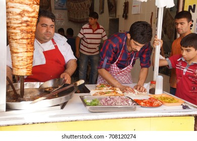 URFA, TURKEY - JUN 8, 2014 - Vendor prepares doner kebab  in Urfa bazaar,  Turkey