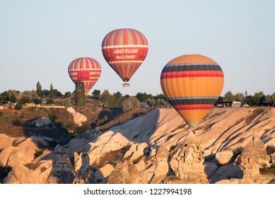 Urgup, Kapadokya / Turkey - 21 June 2017: Anatolian balloons flying over rock valley