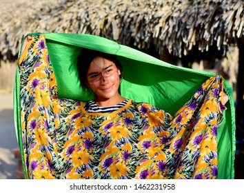 Uribia, Guajira, Colombia; 07/22/2019: Tourist girl dressed in clothes of the Wayuu ethnic group.
