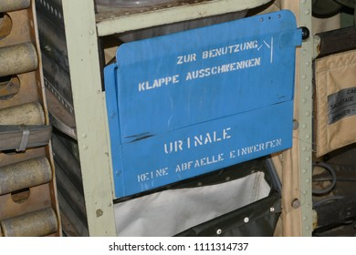 Urinal with the inscription: Swivel out the flap for use - do not throw in any waste - on the inner wall of a miltary transport airplane of the German airforce - Wunstorf, district of Hanover, Germany