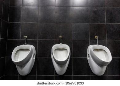 Urinals Men public in toilet room, wc.