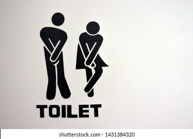 Urinary Urgency Toilet Sign for men and women at the entrance to a public toilet.