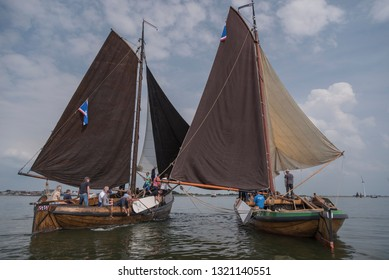 Urk Flevoland The Netherlands 15 June 2018A group of unknown people are holding a sailing race on the lake Unfortunately the wind has gone down