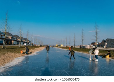 Urk Flevoland Netherlands 27 February 2018, People play on the ice during cold weather at the end of February, kids play ice skate
