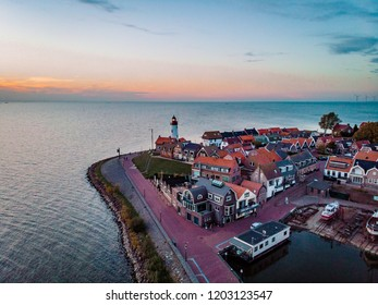 Urk netherlands, aerial view above the light house of Urk Flevoland by the lake IJsselmeer, drone view above the village