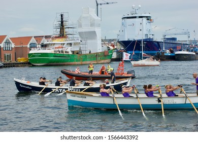 Urk, The Netherlands - june 03 2017: Participants compete for the victory in the rowing contest for sloops during the Urkerdag event in the port of Urk
