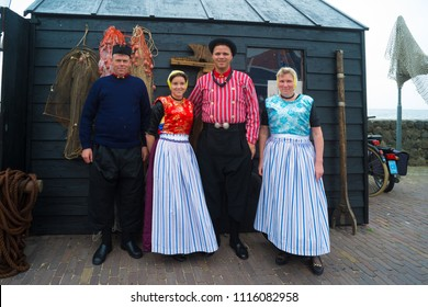 URK, NETHERLANDS - MAY 19, 2018: Unknown people in traditional costumes on the Urkerdays. Urk is on of the best-known fishing villages in the country with the largest fishing fleet.