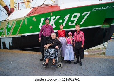 URK, NETHERLANDS - MAY 19, 2018: People in traditional costumes on the Urkerdays. Urk is on of the best-known fishing villages in the country with the largest fishing fleet.