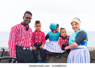 URK, NETHERLANDS - MAY 19, 2018: Unknown family in traditional costumes on the Urkerdays. Urk is on of the best-known fishing villages in the country with the largest fishing fleet.
