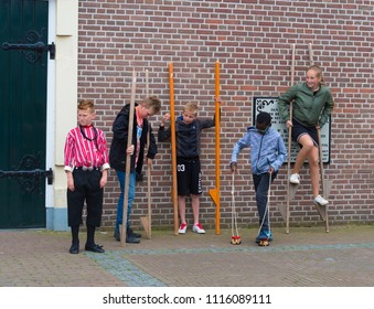 URK, NETHERLANDS - MAY 19, 2018: Unknown children walking stalks on the annual Urkerdays. Urk is on of the best-known fishing villages in the country with the largest fishing fleet.