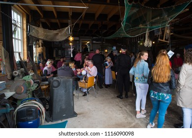 URK, NETHERLANDS - MAY 19, 2018: People hanging around in a fisherman's bar during the annual Urker days. Urk is on of the best-known fishing villages in the country with the largest fishing fleet.