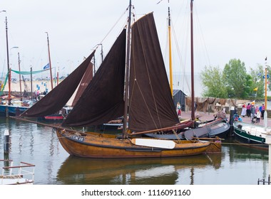 URK, NETHERLANDS - MAY 19, 2018: traditional wooden sailboat in the harbor of Urk. Urk is on of the best-known fishing villages in the country with the largest fishing fleet.