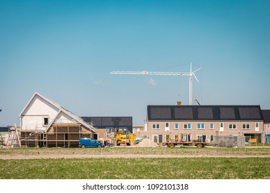 Urk Netherlands May 2018, construction site of new Dutch Suburban area with modern family houses. New build house