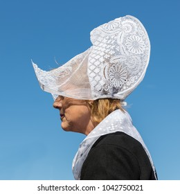 Urk, The Netherlands - September 02, 2017: Woman with traditional clothing and headgear at a local fair with old costumes in Dutch fishing village Urk