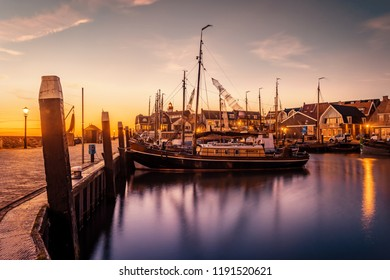 Urk Netherlands, sunset harbor Urk with fishing boats at the old port