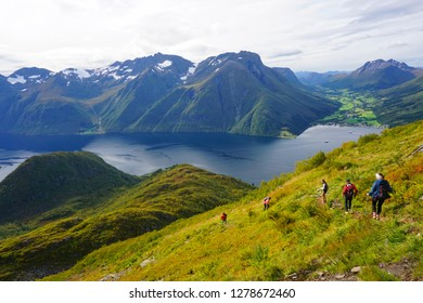 Urke, Norway - September 9, 2017: Hiking on Saksa mountain (Sunnmørsalpene) in Romsdal, Norway, on a sunny day of summer. Amazing fjord landscape