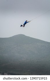 Urla, Izmir, Turkey - May 5 2019: huge kitesurfing megaloop jump performed by kitesurfer athlete on 42 knots wing