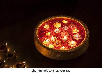 An urn with floating diyas