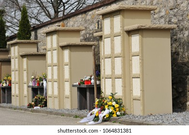 Urn Grave Wall of yellow Sandstone with deposition of Grave Decoration