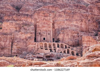 The Urn Tomb, a part of the Royal Tombs of Petra, is carved into the sandstone cliffs with a grand staircase to climb.