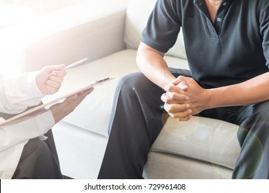 Urologist Doctor giving consult for prostate problems to patient. Urologic oncologists specialize in treating cancer of the urinary tract and male reproductive organs.
