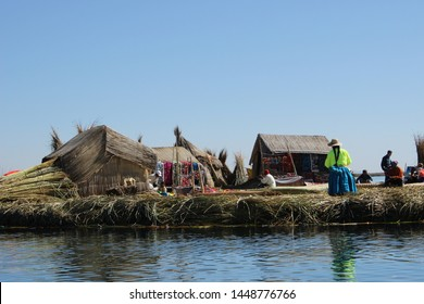 Uros Floating Islands, Titicaca Lake, Puno Region, Peru - August 1st, 2015: The Uros islands are a group of 70 man-made totora reed islands floating on Peru's Lake Titicaca.