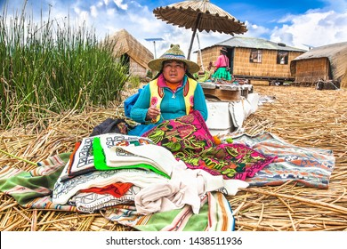 Uros, Peru- Jan 5, 2019: Inhabitants of Uros floating islands sell the rugs, Titicaca lake, Peru.