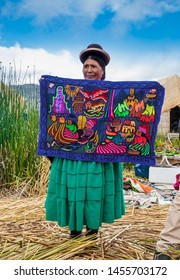Uros, Peru- Jan 5, 2019: Inhabitants of Uros floating islands sell the rugs, Titicaca lake, Peru.
