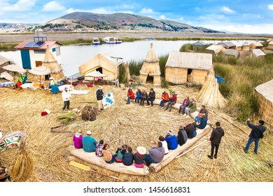 Uros, Peru - Jan 5, 2019. Tourists visit Uros floating islands, Titicaca lake, Peru. South America.