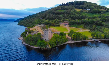Urquhart Castle and Loch Ness in the evening - aerial drone view