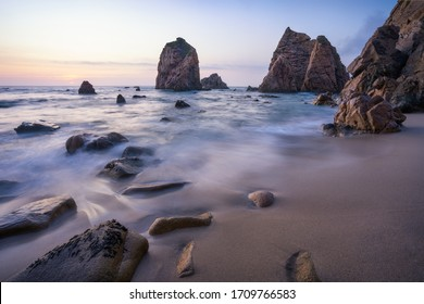 Ursa Beach beautiful coast with sea stack at sunset, Portugal. Atlantic Ocean. Holiday vacation landscape scene