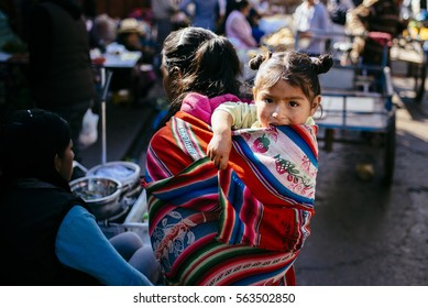 URUBAMBA, PERU, AUGUST 14, 2015: Small child in the children's towel on the market