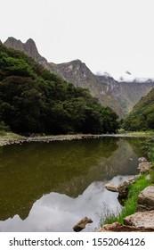 Urubamba river, Aguas Calientes/Peru. Reflecting mountains. Way to Machu Picchu