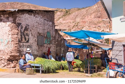 Urubamba, Sacred Valley / Peru - June 13 2017: local street market with peruvians selling and buying local produce such as vegetables and fruits, at noon