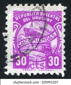 URUGUAY - CIRCA 1938: stamp printed by Uruguay, shows Ship and Train, circa 1938