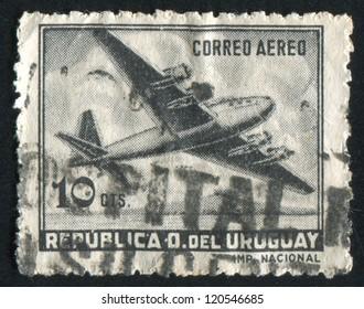 URUGUAY - CIRCA 1947: stamp printed by Uruguay, shows Four-Motored Plane, circa 1947
