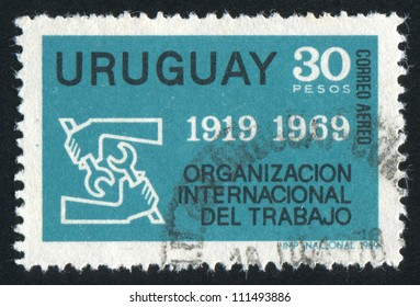 URUGUAY - CIRCA 1969: stamp printed by Uruguay, shows Emblem of International Labor Organization, circa 1969