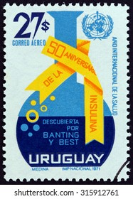 URUGUAY - CIRCA 1972: A stamp printed in Uruguay issued for the 50th anniversary of the discovery of insulin by Frederick G. Banting and Charles H. Best shows Retort and WHO Emblem, circa 1972.