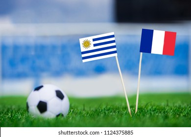 Uruguay and France national Flag on football stadium. Uruguay - France, Quarterfinal. 6. July, Football World Cup, Russia 2018